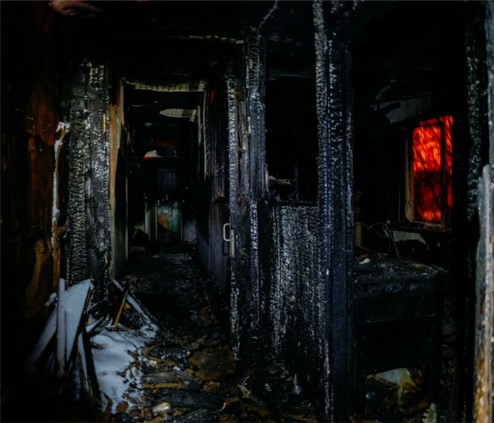 fire damaged interior of a house revealing the inner framework