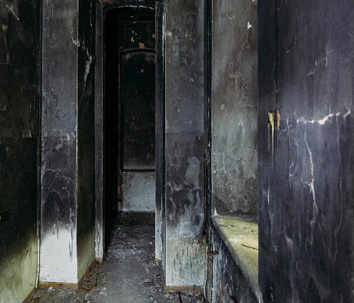 Burnt mansion interior after fire. Walls in black soot